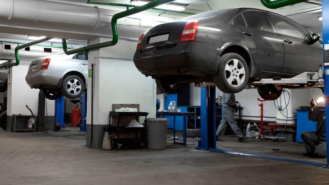 Cars in a garage getting a M.O.T. service